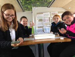 Pupils taking a closer look at the mini-beasts found in their school grounds
